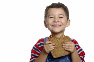 Boy with Peanut Butter and Jelly Sandwich on Whole Wheat